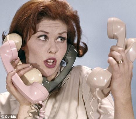 multitasking secretary with phones